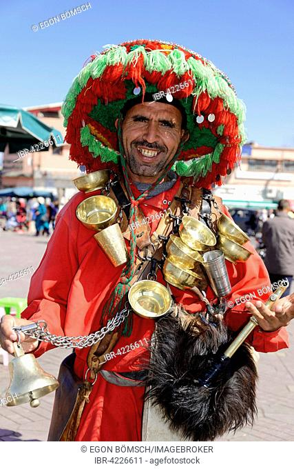 Water seller, Jemaa el-Fnaa, Place of the Hanged, Jugglers Square, Marrakech, Morocco