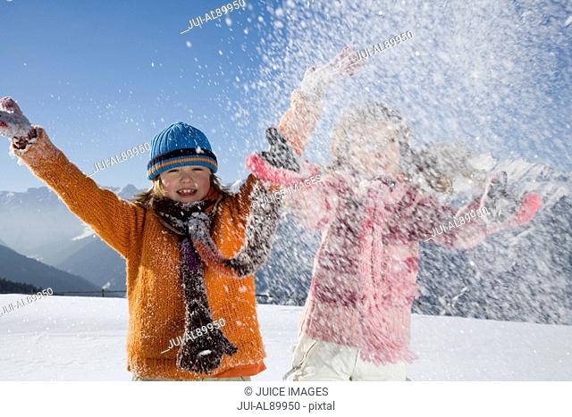 Children playing in snow, Luesener Alm, Dolomite Alps, South Tyrol, Italy