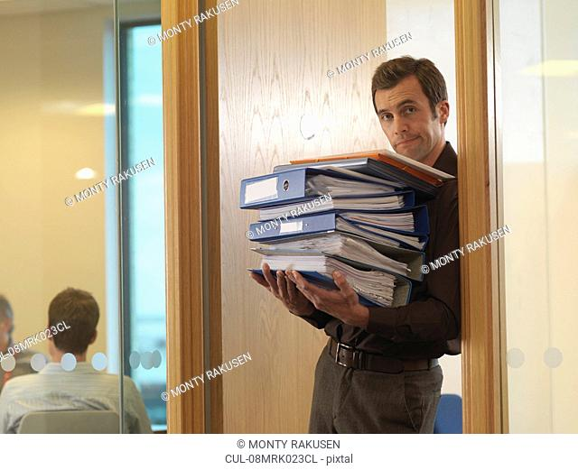 Office staff with files