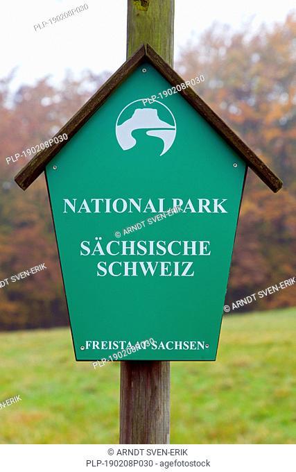 Sign with logo of the Saxon Switzerland National Park / Nationalpark Sächsische Schweiz, Saxony, Germany
