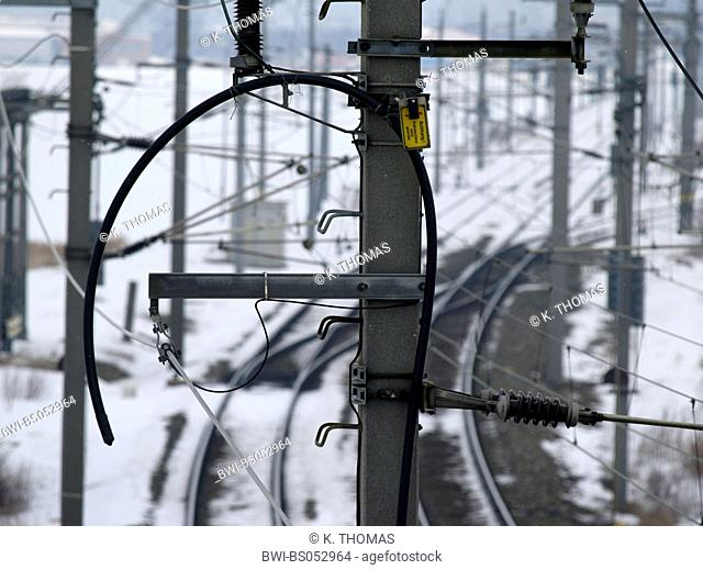 snow covered railway track and catenary winter