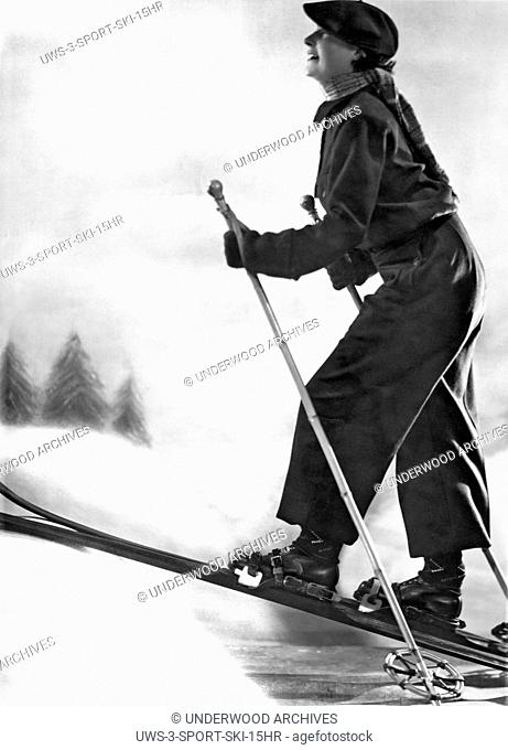 France: c. 1924.A woman cross country skiing in France