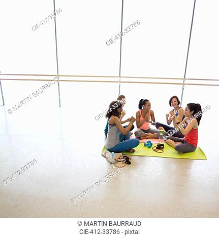 Women gesturing with fists in exercise class gym studio