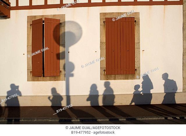 Shadows on wall, Saint-Jean-de-Luz. Aquitaine, France