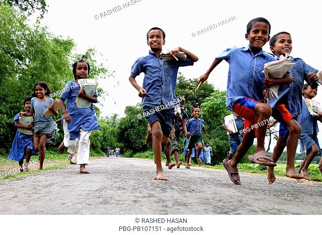 Primary school children return home with pleasure after closing their class Sunamganj, Bangladesh April 2010