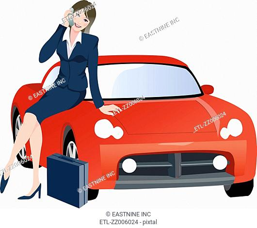 Businesswoman sitting on a car and talking on a mobile phone