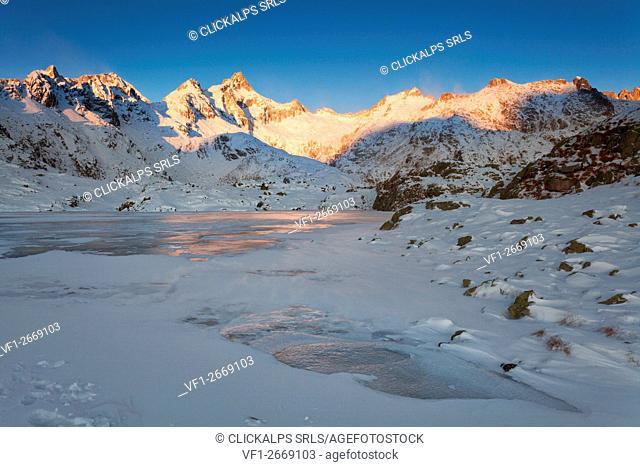 Nero lake, Adamello Brenta natural park, Trentino Alto Adige, Italy. The first lights of a winter sunrise