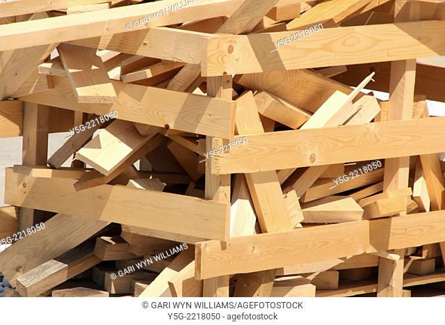 pile of pieces of wood in a box on a building construction site