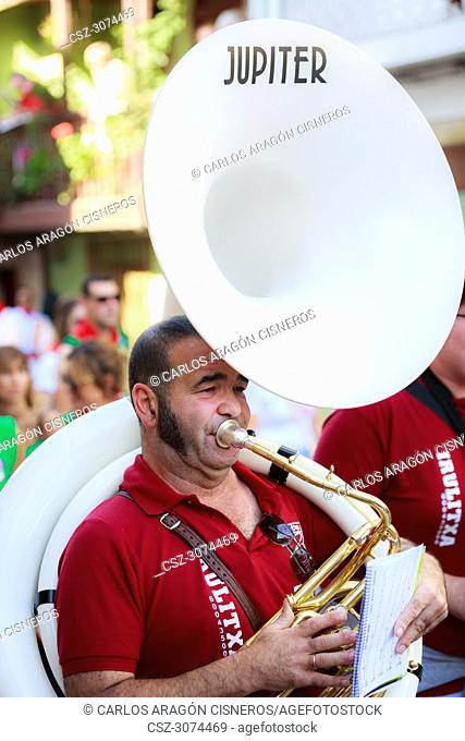 AMPUERO, SPAIN - SEPTEMBER 10: Unidentified musician with a sousaphone before the Bull Run on the street during festival in Ampuero, celebrated on September 10