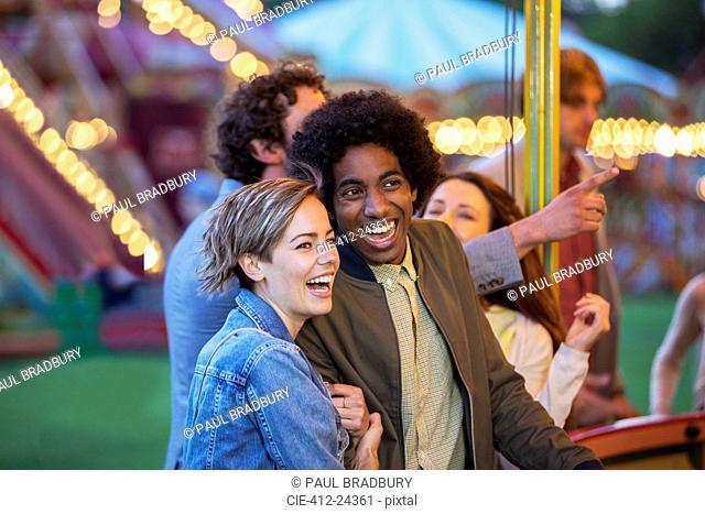 Young multiracial couple having fun in amusement park