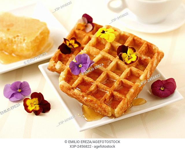 Waffles with honey and flowers