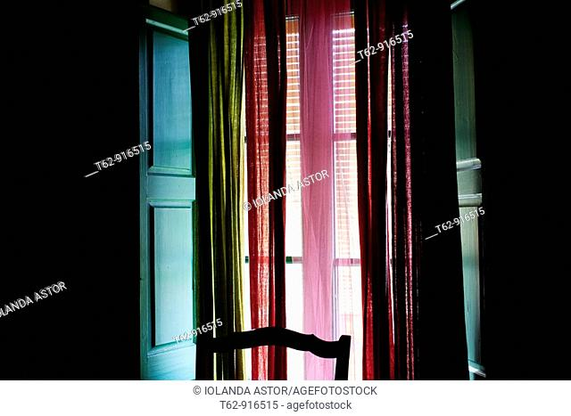 Window with curtains and blinds  Backlit interior  Color