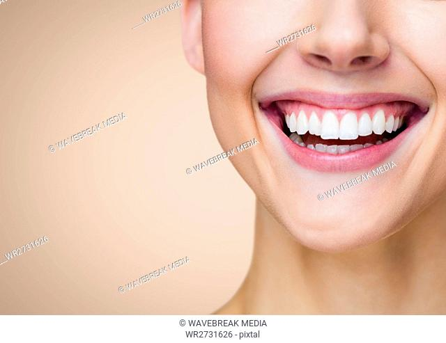 Composite image of a woman smile against beige background
