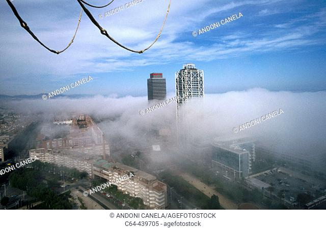 Barcelona viewed from a balloon. Stratus clouds over the city, Catalonia, Spain