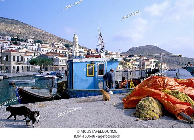 Halki Island of the Dodecanese Chora, fishing boat, fishing nets, cats
