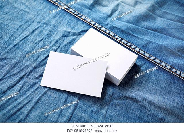 Blank business cards template on denim background. For graphic designers portfolios