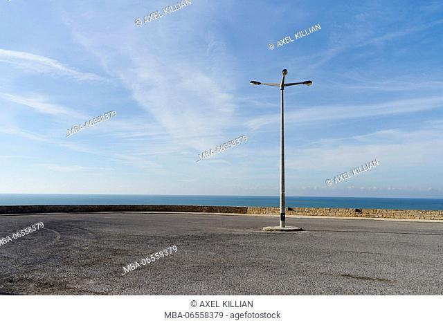 empty parking lot with street lamp on the shore