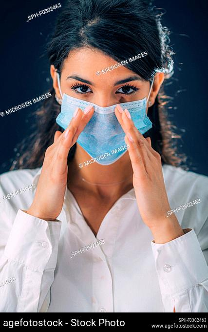coronavirus Infection Prevention. Young woman wearing protective mask