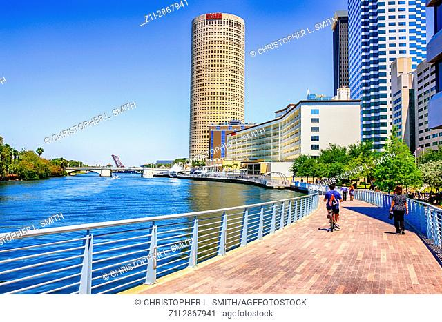 People walking in view of the Rivergate Tower and other skyscrapers in downtown Tampa FL