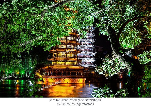 Guilin, China. Sun and Moon Pagodas beside Shan Lake at Night
