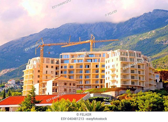 Construction of modern building on green scenic hills on green scenic mounains(Montenegro)