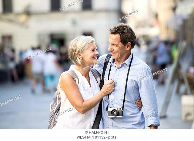 Happy senior couple on city trip