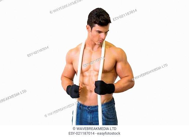 Serious shirtless young muscular man