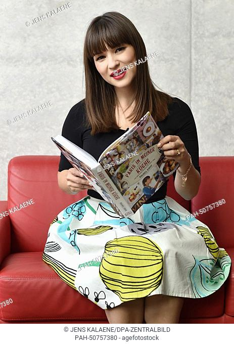 EXCLUSIVE - British cook, author and TV host Rachel Khoo poses with her book 'The Little Paris Kitchen' in Berlin, Germany, 24 July 2014
