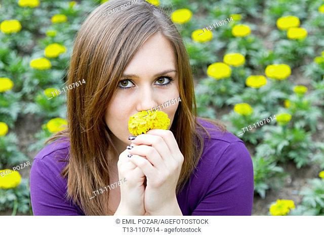 Smelling yellow flower
