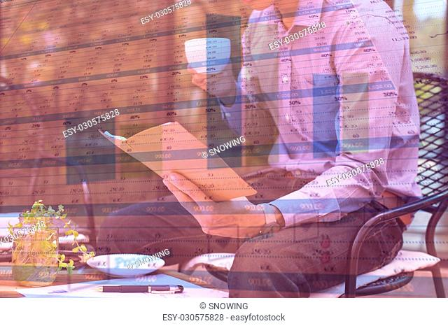 business documents on office table and graph business with social network diagram and man working in the background
