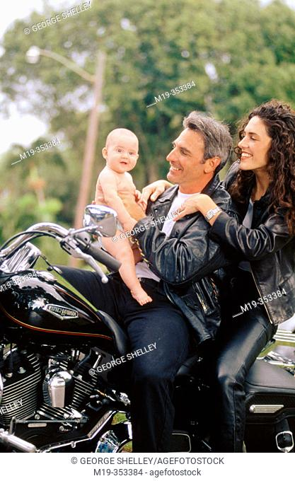 biker couple with baby
