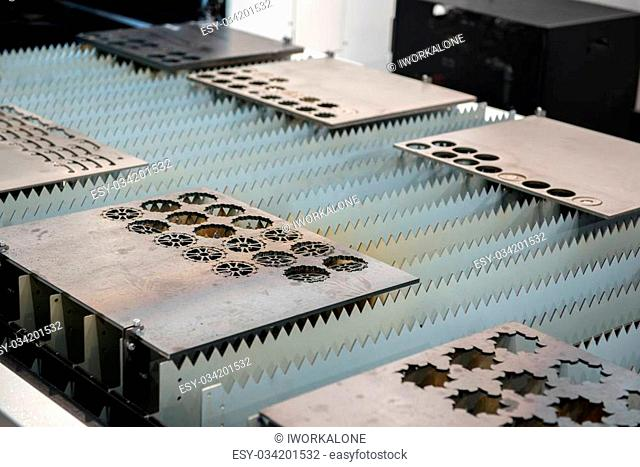 Laser cutter cutting metal plates in a factory