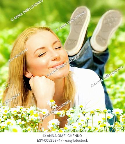 Beautiful female enjoying flower filed