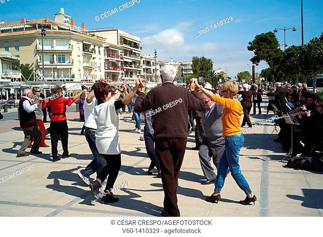 -People dancing Traditional dance, called Sardanas- Cambrils Village in Catalonia (Spain)