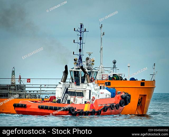 The oil tanker is filled with oil and transported by tug to the open sea, Rosneft oil company, the Black sea