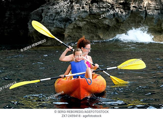 Mother and daughter doing kayaking on Cala Sahona, Formentera, Balearics Islands, Spain. Barbaria Cape