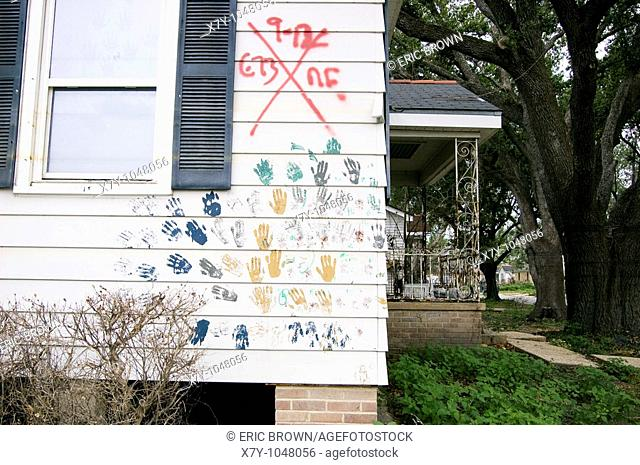 The external wall of a house has hand prints in various colors  9 months after Hurricane Katrina, New Orleans, LA