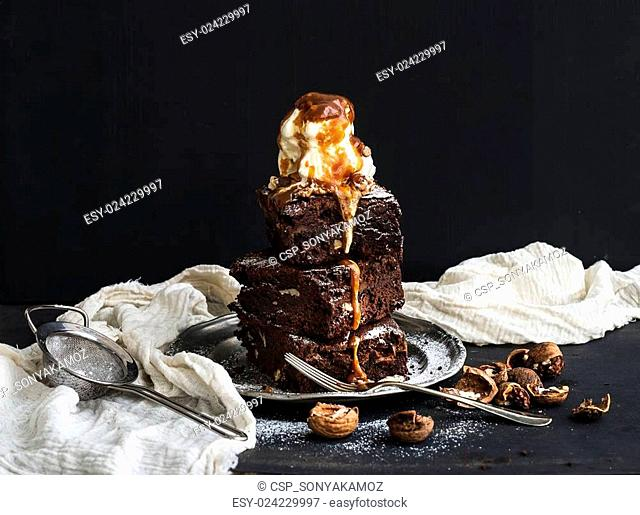 Fudgy Brownies tower with salted caramel, walnuts and ice-cream