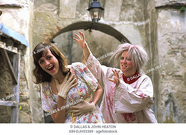 Romania, Transylvania, Sighisoara, Witch with Girl in Folk Costume MR53-01, 03