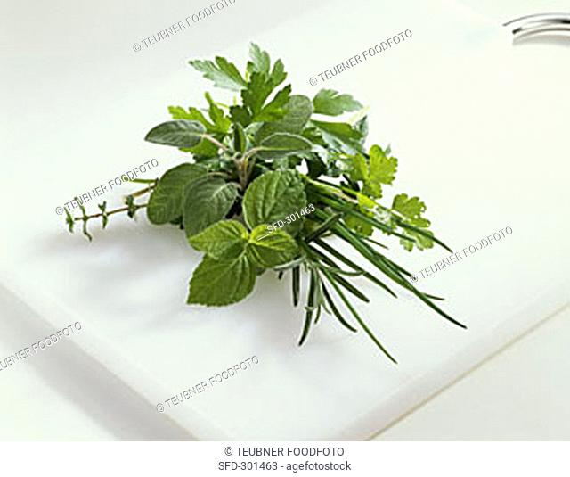 Bunch of herbs on a chopping board