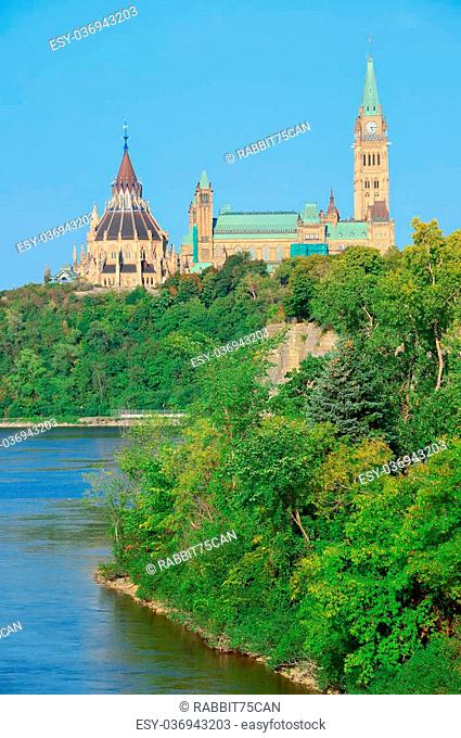 Ottawa cityscape in the day over river with historical architecture