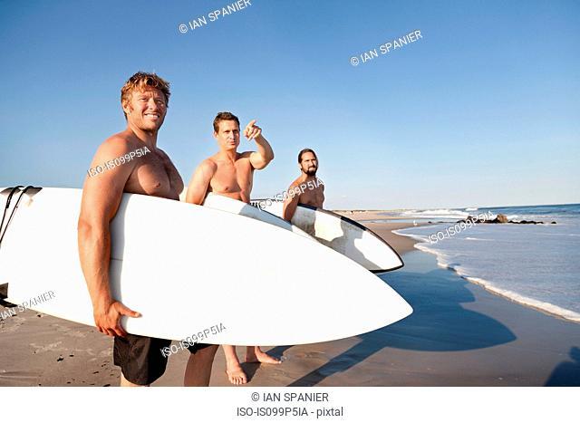 Three surfers at beach