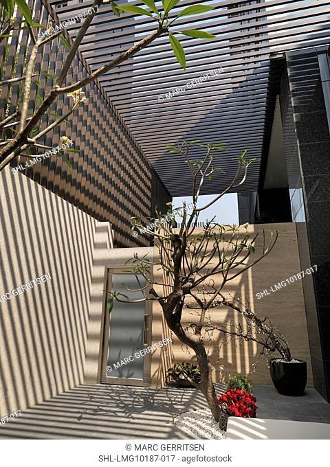 Shadows across entrance to modern home