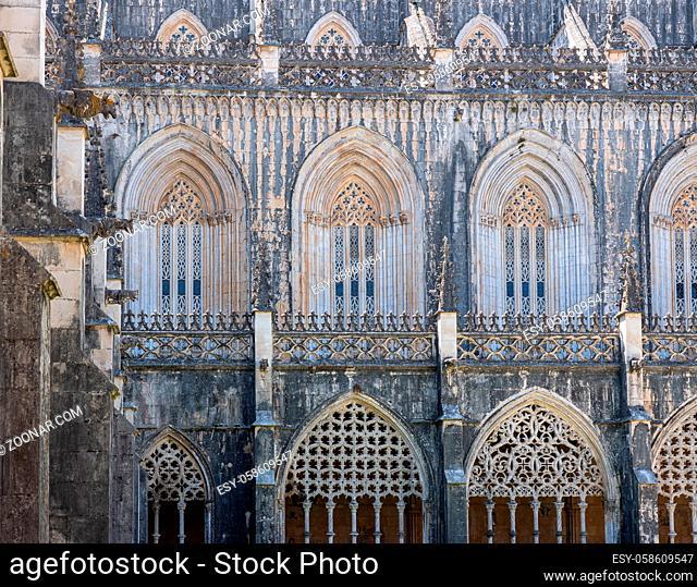 Ornate arches around the cloisters at the Batalha Monastery near Leiria in Portugal