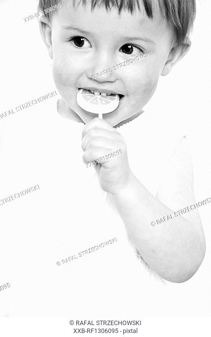baby eating lollypop