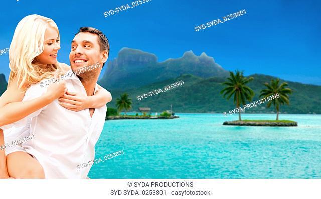 happy couple over bora bora background