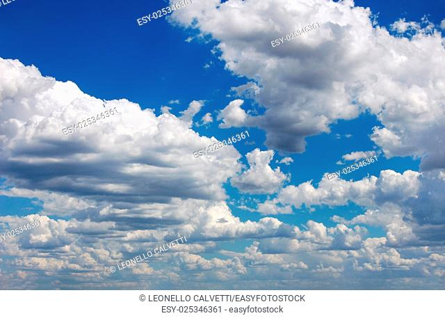 Blue sky with many cumulus white clouds