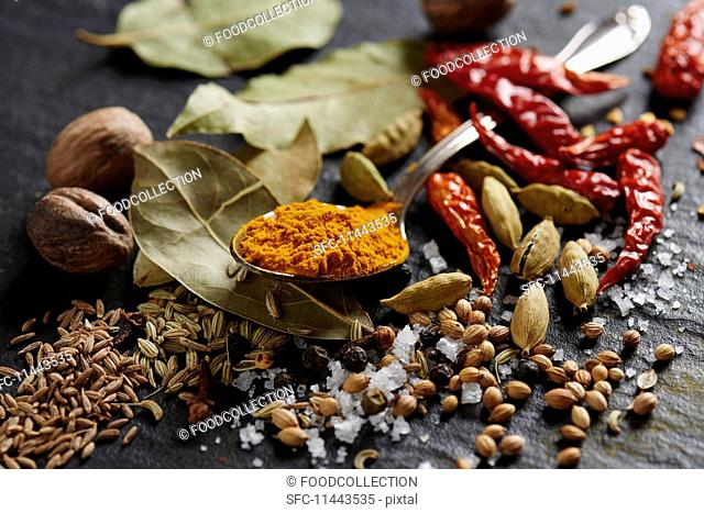 Various spices on a slate surface