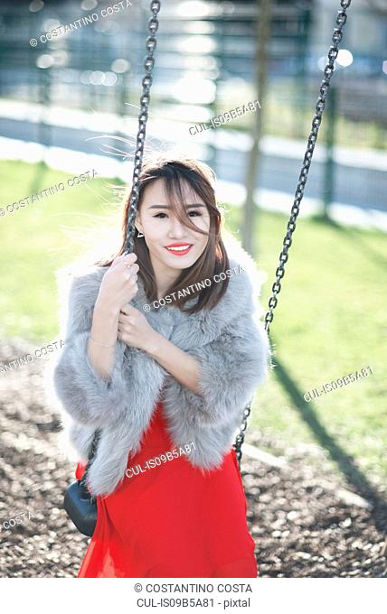 Young woman on swing, Milan, Italy