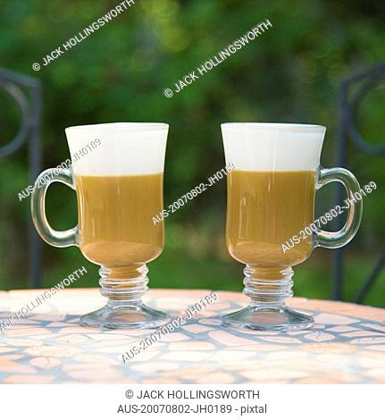 Close-up of two coffee cups on a table